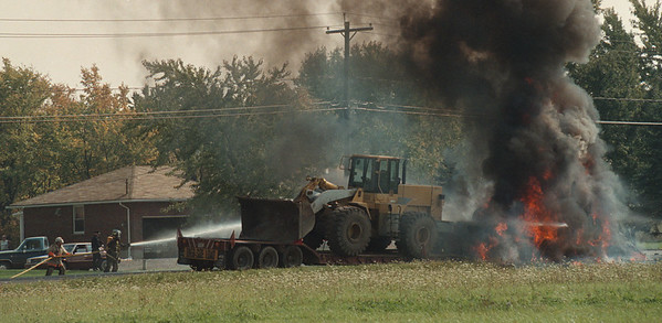 - James Neiss Photo - A truck is in flames after an accidet across from 6369 Nash Road. Shawnee Volunteer Fire Fighters Battle the Blaze.