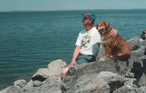 98/05/13 Nice Afternoon *Dennis Stierer Photo - Fred Abramaitys of Niagara Falls enjoys a great afternoon with his 9 year old mixed breed dog named 'Putz' at the Resevoir.  Fred used to breed Putz and she has had a total of 56 puppies before being retired this year.