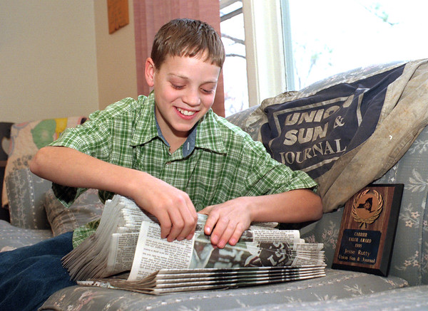 "98/11/09 Counting Papers *Dennis Stierer Photo -<br /> Jesse Rutty, a Lockport Union Sun & Journal paperboy, counts his daily delivery route. Jesse recently received an honor entitled ""Carrier Valor Award"" for helping one of his customers."