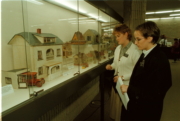 98/12/09 Toy Houses - James Neiss Photo - L-R - Sister Erin Johnson and Sister Suzanna Galbraith, both of Lewiston, look over an exhibit of Toy houses on display through the end of the first week of January at the Main Branch of the Niagara Falls Library. The Toy Houses are from a Private collector, are mostly hand made and span from the late 1800Õs to the present.