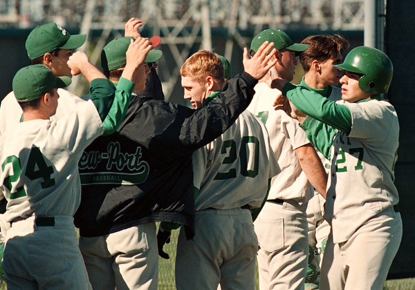 5/27/97--BASEBALL B&W--DAN CAPPELLAZZO PHOTO--LEWPORTS' PETE NASTASI GETS THE HIGH FIVES FROM TEAMMATES  AFTER CROOSING HOME IN THE FIRST INNING.<br /> <br /> SP