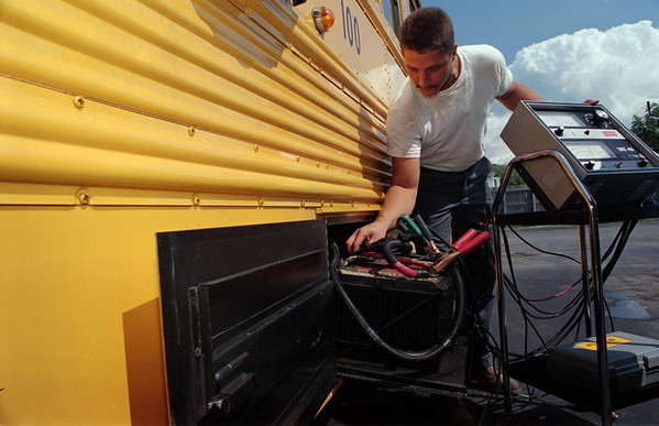 98/09/03 Boring Bus-Rachel Naber Photo-Dave Reigle an employee of the Medina Central School transportation department checks the electrical system on a school bus.