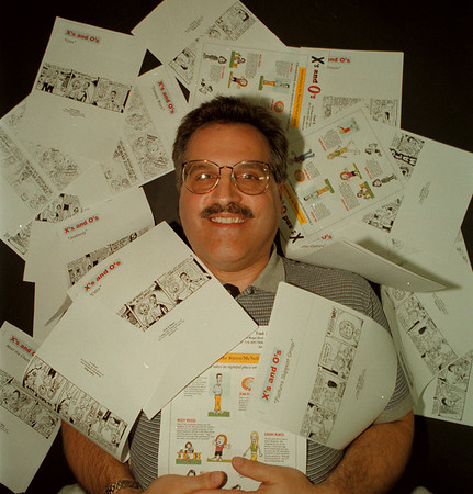 "98/12/03 Frank Mariani - James neiss Photo - Cartoonist with his comic strip ""X's and O's""."