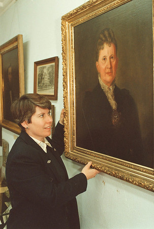 3/1/97-- hostrical society-- Takaaki Iwabu photo-- Melissa Dunlap, executive director of Niagara County Historical Society, shows the painting of Belva A. Lockwood, one of the local women who accomplished various things and are feautred  in the Society. (for story on Women's history month)<br /> <br /> feature, Sunday