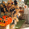 97/09/27 Harvest Fest--Takaaki Iwabu photo-- Visitors to Lewiston Harvest Festival check the halloween items at Newtiques, one of the many craft-stands on Center Street Saturday.