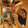 1/24/97 School Reportcard 3 - James Neiss Photo - William Pinkney and Heather Hailey, both 17/12th at LewPort HS, work on a Car Launcher for the Science Olympia.
