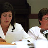 98/07/23 Smokers Vote2-Rachel Naber Photo-Dr. Jean Wactawski-Wende (left) reads revisions made to smoking regulations in NiagaraCounty as as Barbara Brewer and other  comitte members listen before the vote.