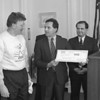 1/17/97 Reebok Prism - James Neiss Photo - L-R - The Rev. Robert Heisner, Project Fuiture Way, and  PRISM  program creater,  recieved a check from State Attorney General Dennis Vacco from funds recieved from a law suit against Reebok. Other dignitaries involved in obtainting the funds including Senitor George D. Maziarz attended.