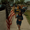 98/05/27 GJ Mann Parade - James Neiss Photo - Sarah Jackson 8yrs Leads her 3rd grade class with old glory during the schools 40th anniversary parade. GJ Mann Elementary School.