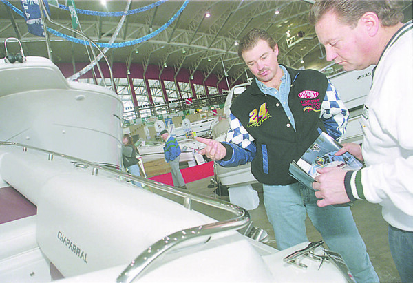 1/11/96--boat show-- Takaaki Iwabu photo-- Gary Bommer, right, sales advisor of Collins Marine, shows one of the boats displayed to Rick Korpolinski of Youngstown at Boat Show at Niagara Falls Convention Center Saturday. <br /> <br /> local, Sunday