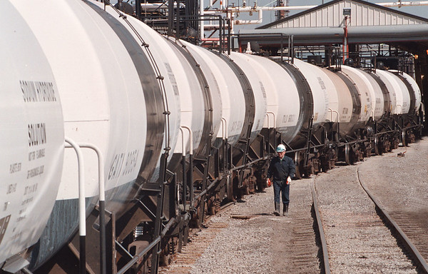 4/10/97--CAUSTIC/OLIN CHEMICAL--DAN CAPPELLAZZO PHOTO--OLIN CHEMICAL CAUSTIC OPERATOR CARL BLOSS INSPECTS RAIL CARS, AT THE BUFFALO AVE PLANT, THAT WILL BE FILLED WITH CAUSTIC MATERIAL FOR SHIPPMENT.<br /> <br /> NEWS/1A