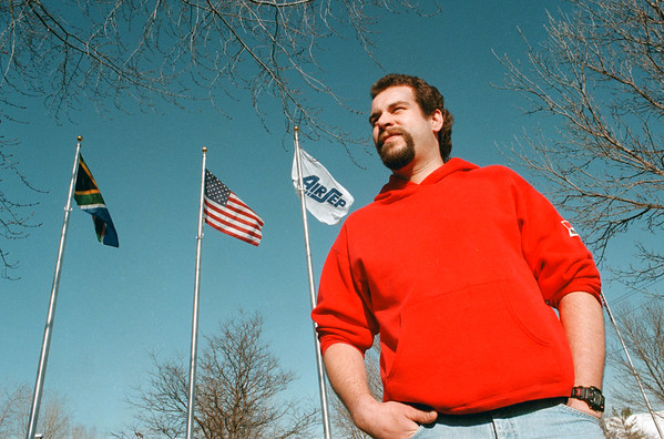 98/01/12--JOBS/AIRSEP--DAN CAPPELLAZZO PHOTO--BOB GEORGE STANDS IN FRONT OF THE FLAGS AT AIRSEP CORP, CREEKSIDE DR. AMHERST.<br /> <br /> SUNDAY FEATURE