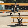 "97/09/21--NF AIRSHOW--DAN CAPPELLAZZO PHOTO--6-YR-OLD GINO LoBIANCO, OF N.F., FLIES WITH THE BIG BOYS AS HE PEDDLES HIS ""1929 FLEET"" TOY PLANE IN FRONT OF 1937 STEARMAN VINTAGE AIRPLANE ON THE TARMACK AT THE NF AIRPORTS' ANTIQUE AIRSHOW.<br /> <br /> LOCAL"