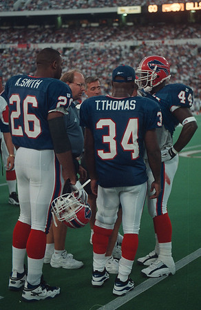 97/08/30 -- A. Smith 2 -- Takaaki Iwabu photo-- A. Smith with other two RB, T.Thomas and Derick Homes. (from pre-game with Vikings..)