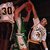 1/21/96-- basketball --Takaaki Iwabu photo-- LaSalle High School James Davis (30) and Patrick MacKenna block the Lew-Port offender's shot. <br /> <br /> sports, wednesday