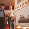 98/02/08 Somerset 175th - James Neiss Photo - Barker Volunteer Fire Fighter George Brigham Sr. and Frederick Atwater, both of Barker look at some of the historic photos including the Thirty Mile Point Lighthouse during  the Town of Somerset 175th Anniversary celebration at the Barker school facilities.