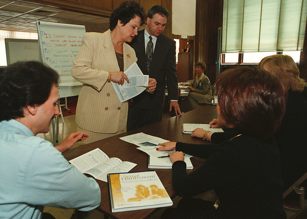 5/15/97--HARASSMENT SEMINAR--DAN CAPPELLAZZO PHOTO--ATTORNEY MARY JO McGRATH (CENTER) TRAINER W/McGRATH SYSTEMS INC, AND WILLIAM D. BERARD III, ASSISTANT SCHOOL DISTRICT ATTORNEY FOR THE NF SCHOOL DISTRICT SPEAK WITH NF SCHOOL REPS AND ADMINISTRATORS ABOUT SEXUAL HARASSMENT IN THE WORK PLACE.<br /> <br />  LOCAL NEWS