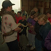 98/05/04 - Captive Breeding *Dennis Stierer Photo - Michael Napolitano is hold a Python snake, while 6th graders from Holly Middle School get to pet and touch the snake and a lizard that he brought. Michael talked about the care and raising of reptile animals.