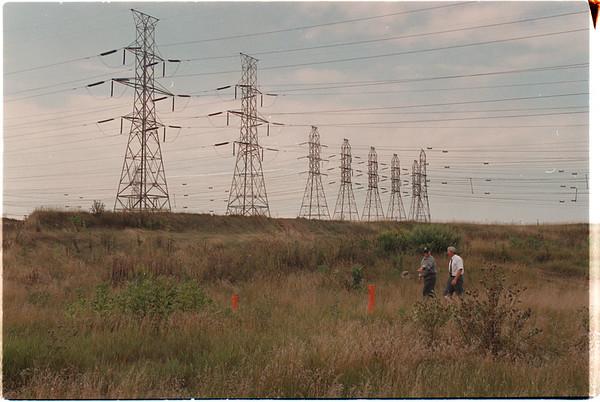 97/08/25 Vanadium - James Neiss Photo - Michael J. Hinton, Environmental Engineer with the NYS Department of Conservation and Dan King, Regional Hazardous Waste Engineer walk toward boringÕs at the Vanadium Dump Site.