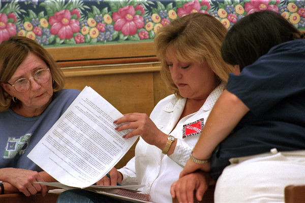 98/07/23 Smokers Vote-Rachel Naber Photo-(left to right) Sharon Weisbabeck, Judi Justiana, and Brenda Bellina read revisions made to the smoking regulations that were approved by the comittee.