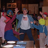 "98/02/06 Winterfest 3 *Dennis Stierer photo - Being introduced as ""The Devourer"", Ted Werner, principal at Emmett Belknap school makes his entrance to the pie eating contest. He is greeted by Lockport,Exchange Club Circus Clowns."