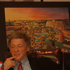 98/03/18 Edwin A. Cogan - James Neiss Photo - A artist rendering of what down town Niagara Falls could look like is behind  Edwin A. Cogan as he talks about the state of the redevelopment to down town Niagara Falls, NY.