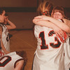 98/03/03--Falcons 1--Takaaki Iwabu photo-- Niagara-Wheatfield Janelle Mahl, right, consoled by her teammate Jennifer Grawe (#13) after the team lost to Lakeshore HS.  Keeping her head down is Kim Hoyt.