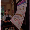 7/29/97 Card History - James Neiss Photo -  Alison Judd, Curatior-Printer at the Mackenzie Heritage  Printery in Queenston, Ontario shows off a sheet of uncut International Playing Card Co. Cards on display at the museum.