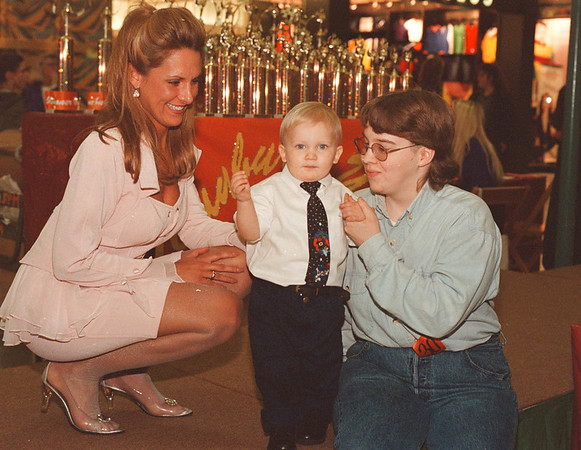 3/1/97-- beauty queen--takaaki iwabu photo-- Jeffery Crooks, 2, gets ready for the stage act with his mother Chris, right, and Tracie Spooner of Sun Burst USA Beauty Pagent at Summit Park Mall Saturday. <br /> <br /> tmc photo