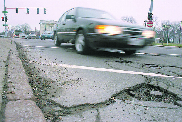 1/4/96-- bad road --Takaaki Iwabu photo-- Picture on Fourth St. and Main St. (for McBride's story on deteriorating road conditions in NF)<br /> <br /> 1A Monday/Topic