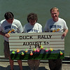 98/07/29 Duck Rally Promo-Rachel Naber Photo-(left to Right) Jack Beedon, Kathy Blair and David Callard of the United Way advertise for the duck rally that will be held at the canal on August 15th.