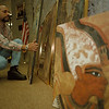 99/1/5 John Myles Jr. - Vino Wong Photo - John Myles Jr. shows his Egyptians Series art work can be seen at the Niagara Falls Public Library.
