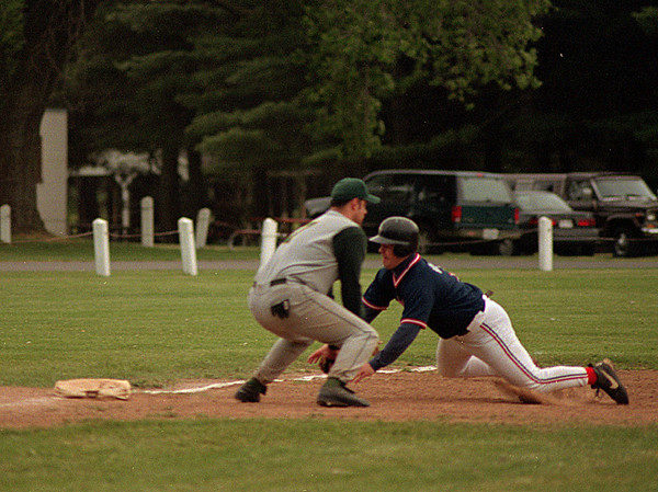 98/06/05  Going For Third *Dennis Stierer Photo - Lockport Busmen  Aric Hayden  tries unsuccessfully to tag  Rob Vickers  with Lockport DMI  out as he slides into third. Rob was declared safe at third.