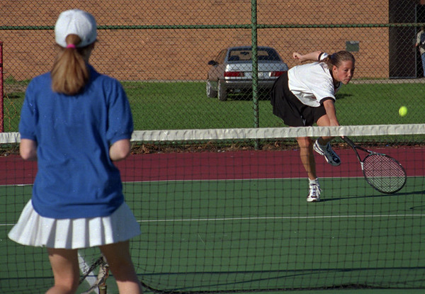 97/10/06--TENNIS--DAN CAPPELLAZZO PHOTO--NW SOPHMORE BECKY SHEEHAN (WHITE) RETURNS A VOLLY AS GI SR. JULIE CASTIGLIA WAITS FOR THE BALL AT NW HIGH.<br /> <br /> SP