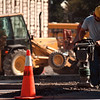 98/01/10 Pave Ent-Rachel Naber photo-Nathan Duerr of RIC  resurfaces a piece of the street on the jobsite behind the new Walgreens in Lockport.