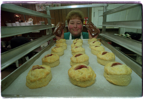 7/28/97 Village Bake Shop - James Neiss Photo - Tracy Marshall, owner and pastry chef of the Village Bake Shop in Lewiston will be one of the attendees at the Taste of Lewiston... Here she shows off Raspberry Jam Scones fresh out of the oven and holds a couple tasty Tea Breads.