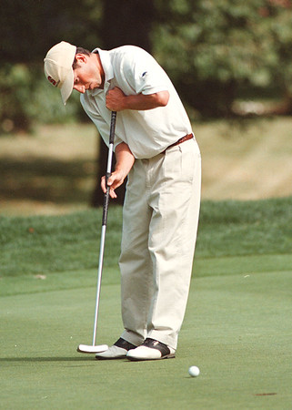 7/25/97--porter cup 2--takaaki iwabu photo-- Tim Clark uses a long putter. (He is in the second place)