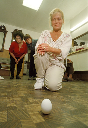 3/20/97 Vernal Equinox Egg - James Neiss Photo - Hairdressers stand egg on end on Vernal Equinox - Pat Shira Forground shows off the egg she stood on end at 8:55 am which stood for nearly 3 hours to customers delight. Behind are Owner Donna Earp and Bary Ann Pasqualichio. All Hairdressers at Salon Donna Marie on Pine Ave.