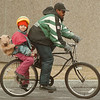 98/03/09--what're y lookin at? --Takaaki Iwabu photo-- Triple riding? Jose Luis Velacqucz rides a bicycle with his daughter Gail, who has her koala-backpack on her back Monday near Niagara Falls Library. He picked Gail up from Head Star School. <br /> <br /> grapevine photo