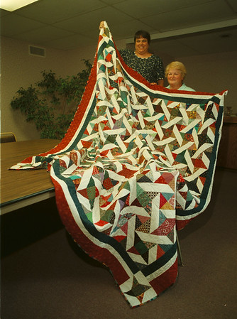 "98/09/15 Quilters - James Neiss Photo - L-R - Nancy Babis, Quilt Show Chairman and Gretchen Lang, publicity Chair show off a quilt that will be at ""Remembrance 98 Quilt Show by the Kenan Quilters Guild."