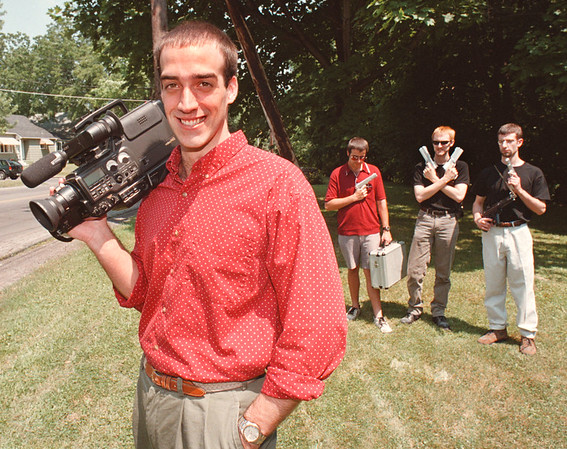 7/13/97--NIAGARA GRANT/FILM MAKER--DAN CAPPELLAZZO PHOTO--LOCAL FILMAKER CHRISTOPHER FOREMAN, WHO WAS AWARDED A $1500.00 GRANT FROM THE NIAGARA COUNCIL OF THE ARTS POSES WITH HIS CREW (LTOR) BROTHER SCOTT FOREMAN, CHRIS COSGRAVE AND JIM ZITO, ALL OF NF. THE CREW IS HOLDING TOY GUNS BECAUSE IT WILL BE AN ACTION FLICK.<br /> <br /> FEATURE