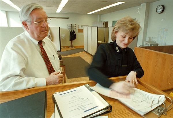 2/28/97-- new office --Takaaki Iwabu photo-- Captain James E. Gray and officer Angela Dobrasz work at juvenile office, which was recently converted to the office from court room.<br /> <br /> Monday, 1A