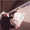 2/7/97 Ultimate Fighting - James Neiss Photo - Matthew Pattison of Toronto, Ontario shows off a sign and his ticket for the cancled Ultimate fighting Championship fights that were cancled at the naigara Falls Convention Center. He has a ticket in his mouth for a free tv viewing to be held at the convention center itself.