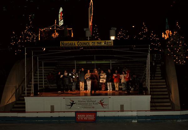 97/12/09--NC SINGERS/LACKEY PLAZA--DAN CAPPELLAZO PHOTO--THE NC  CHORUS SING XMAS TUNES AT THE LACKEY ICE RINK.<br /> <br /> GRAPEVINE