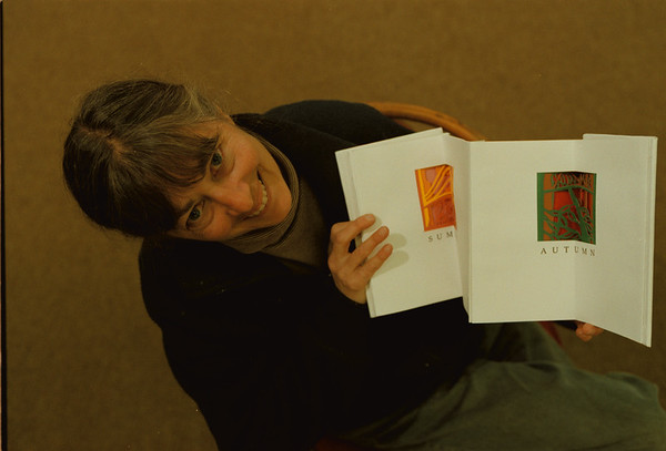 "98/11/06 Book Artist - Vino Wong Photo - Carol Schwartzott a book artist and designer holds her original book titled ""Goat Island Journal 1993"" a limited edition  will be on sale at the public library on Saturday, November 14, at 9:00 am. The art sale also feature several local artists' original art and prints."