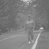 98/11/07 Bike path-Rachel Naber Photo-Tony Mooradian a resiodent of Youngstown walks along Route 18f where the road will be widened.