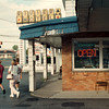 7/11/97- Riviera Motel--Takaaki Iwabu photo-- Tourists pass in front of the entrance of Riviera Motel on Niagara Falls Blvd. (Property is part of City auction) <br /> <br /> 1A, Monday, color