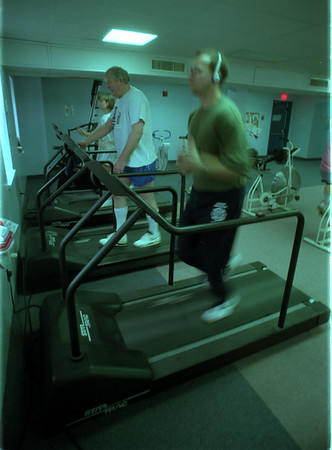 98/01/12 Pacing One Self - James Neiss Photo - L-R - Lockport YMCA - Catherine Kern  and  Pat Hannigan choose a slower pase on the YMCA tred mills as Ben Lesold goes so fast he's just a blur. All are from Lockport.