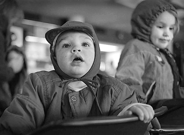 1/11/96-- waitng --Takaaki Iwabu photo-- A-year-and-half-old Zachary Laird watches the skaters from waiting room in Marine Midland Centennial Ice Rink as his family member puts their skating shoes on Saturday. The Lairds, Alexander, N.Y., visit Festival of Light this weekend.<br /> <br /> Grapevine photo