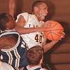 98/01/26--LASALLE HOOPS--DAN CAPPELLAZZO PHOTO--;LASALLE'S NATE MERCHANT COMES DOWN WITH THE REBOUND AGAINST A PACK OF SWEET HOME PLAYERS.<br /> <br /> SP
